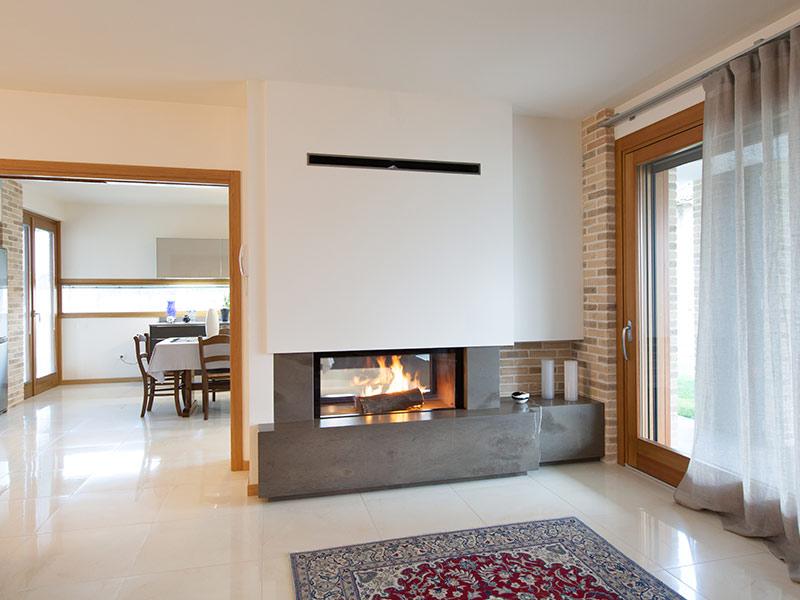 Camini a legna con vetro il caminetto - Camini moderni ad angolo design ...